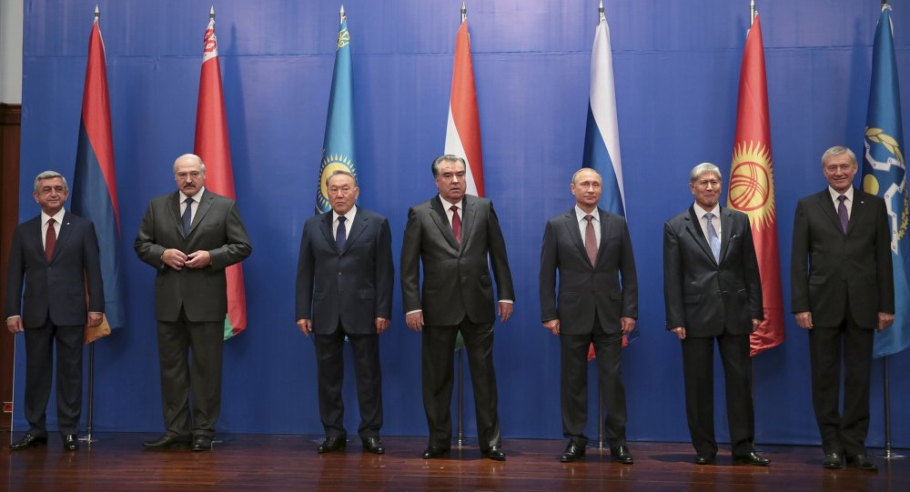 (From L to R) Presidents Serzh Sargsyan of Armenia, Alexander Lukashenko of Belarus, Nursultan Nazarbayev of Kazakhstan, Emomali Rahmon of Tajikistan, Vladimir Putin of Russia, Almazbek Atambayev of Kyrgyzstan and the organization's Secretary General Nikolai Bordyuzha pose for an official photo as they attend a session of the Collective Security Treaty Organization (CSTO) in Dushanbe, Tajikistan