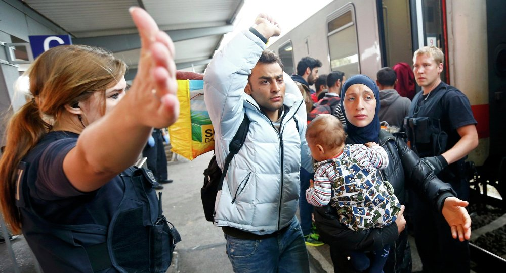 Police directs migrants at a train station near the border with Austria in Freilassing, Germany September 15, 2015.