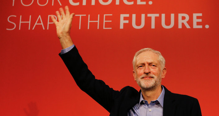Jeremy Corbyn waves on stage after new is announced as the new leader of The Labour Party during the Labour Party Leadership Conference in London.