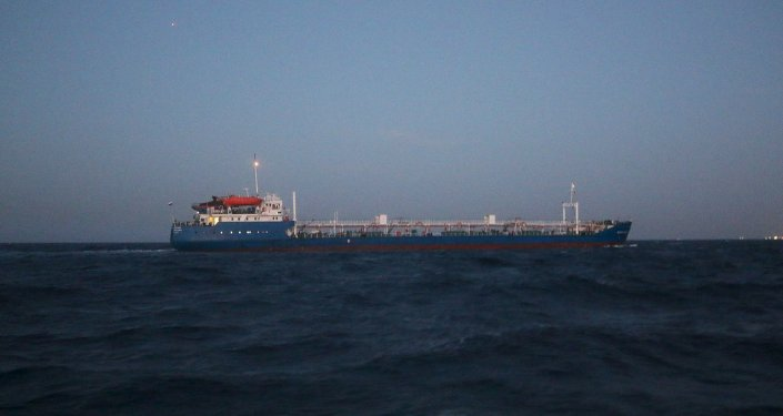 A Russian-flagged oil tanker is seen in Tripoli Naval Base after coast guard of the central region guards captured it