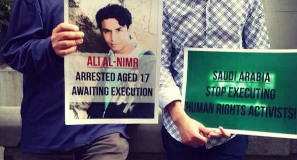 Demonstrators hold a picture of Ali Muhammed al-Nimr after his appeal case failed.