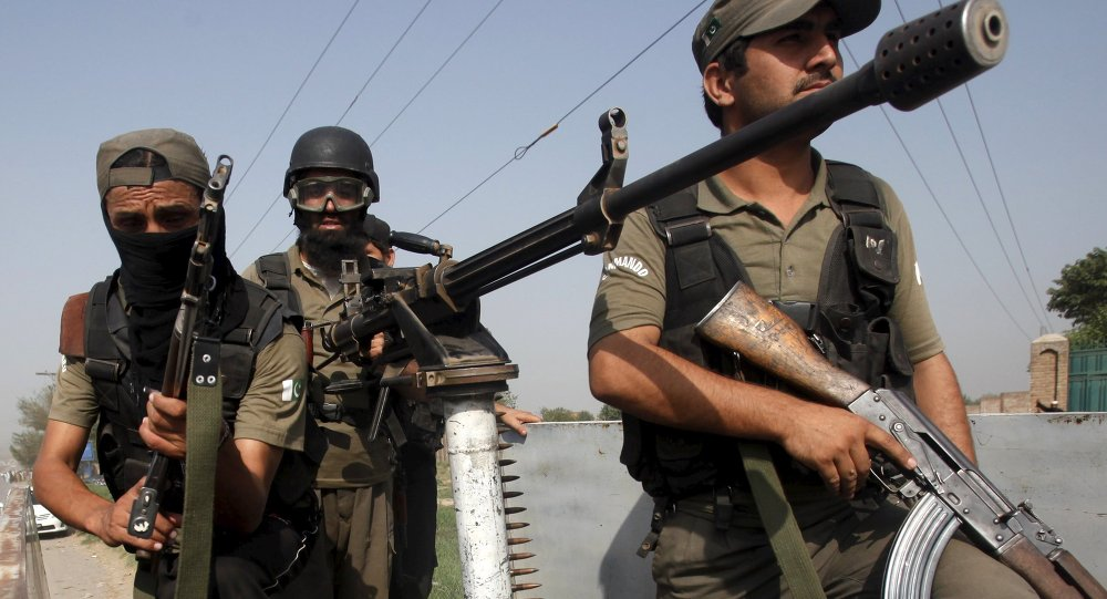 Soldiers arrive to repel an attack on an air force base in Peshawar, Pakistan