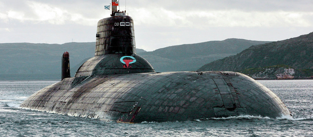 One of Russia's largest Soviet-built nuclear submarines, Typhoon (Akula) class, which remains the world's largest with the displacement of about 25,000 metric tons (27,500 tons) heaves ahead in the Barents Sea at Russia's Arctic Coast in this September 2001 photo