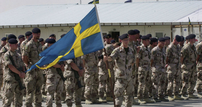 Swedish soldiers part of the International Security Assistant Force (ISAF) stand during a changing of command ceremony at the Swedish run Provincial Reconstruction Team in Mazar Sharif north of Kabul, Afghanistan on Tuesday May 6, 2008