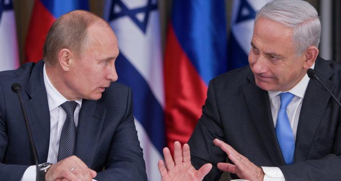 Russian President Vladimir Putin, left, listens to Israeli Prime Minister Benjamin Netanyahu.