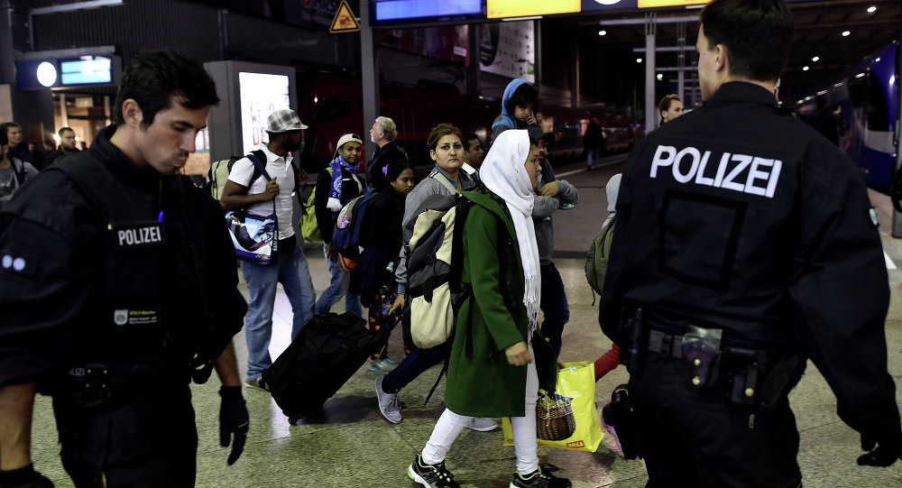 Syrian refugees and migrants are escorted to be registred by German police officers upon arrival from Austria at the Munich's main train station late September 3, 2015.