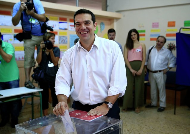 Leader of left-wing Syriza party and former Prime Minister Alexis Tsipras casts his vote at a polling station in Athens, Sunday, Sept. 20, 2015