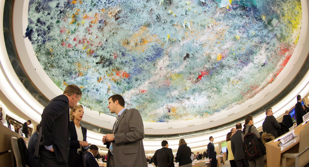 Delegates are seen beneath a ceiling painted by Spanish artist Miquel Barcelo during 28th Human Rights Council at the United Nations headquarters in Geneva on March 2, 2015.