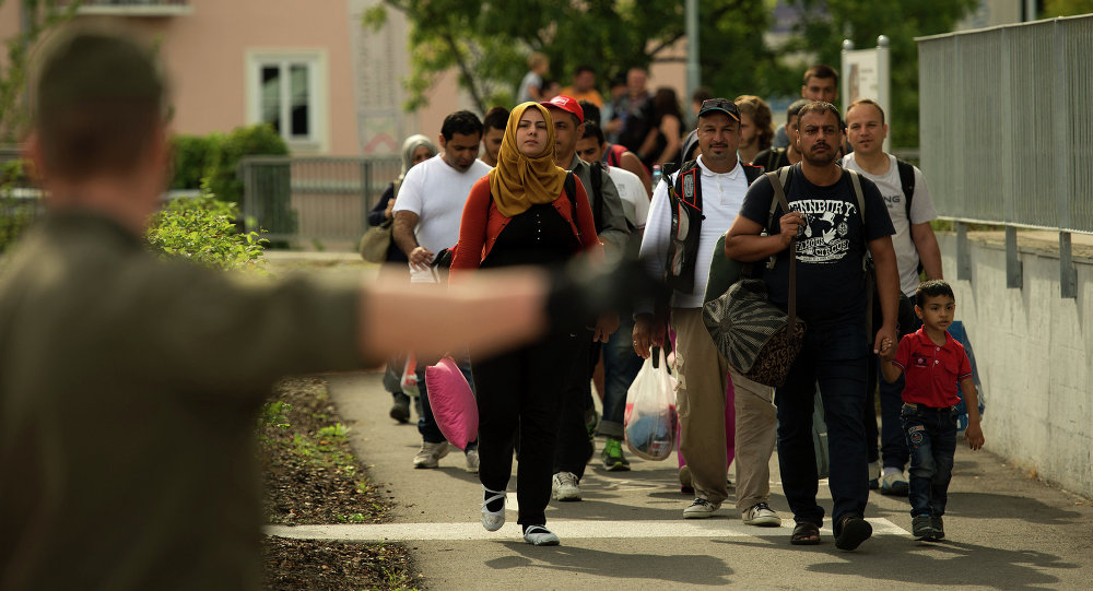 Migrants crossing the border between Austria and Slovenia in Bad Radkersburg, about 210 kms (130 miles) south of Vienna, Austria, Sunday, Sept. 20, 2015.