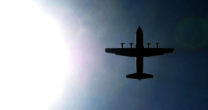 A Canadian Royal Air Force C-130J Hercules passes over the 'Strike' Drop Zone at Fort Polk, La., Aug. 16, 2013.