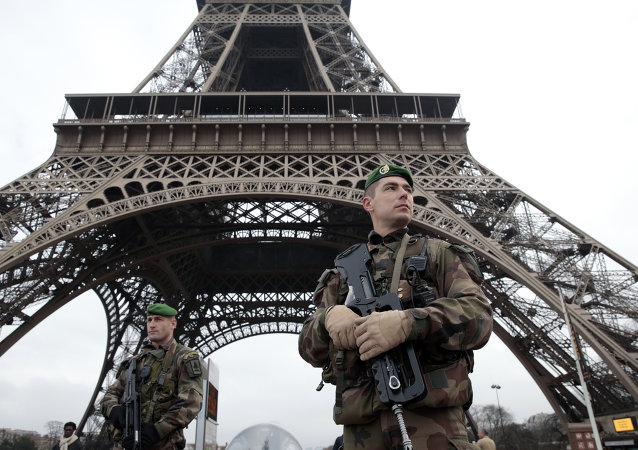 French soldiers patrol in front of the Eiffel Tower on January 7, 2015 in Paris as the capital was placed under the highest alert status after heavily armed gunmen shouting Islamist slogans stormed French satirical newspaper Charlie Hebdo and shot dead at least 12 people in the deadliest attack in France in four decades