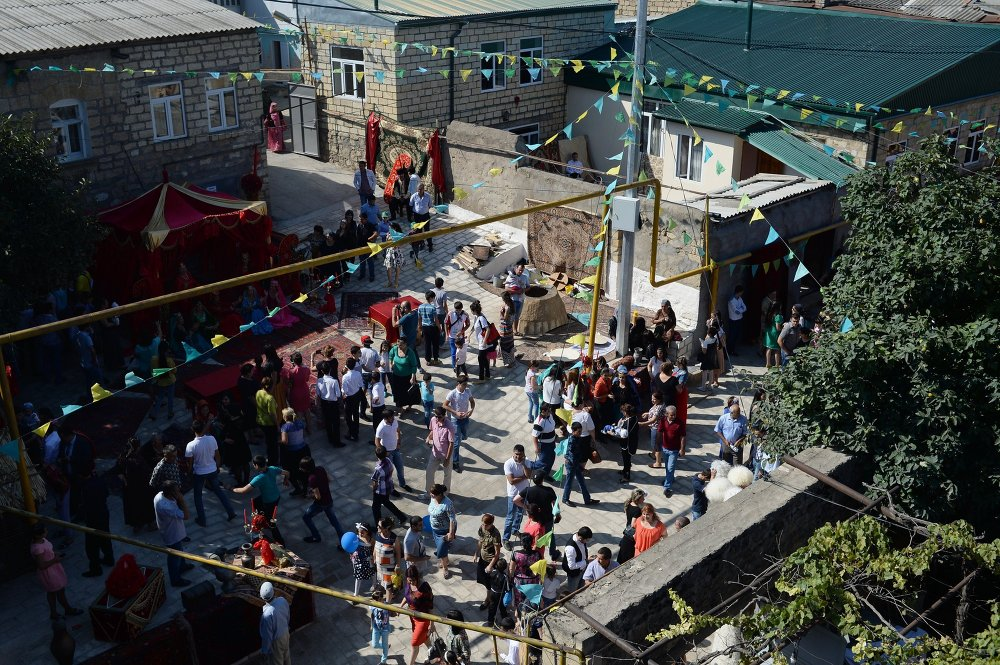 Residents and guests in the area of the ancient city of Magal during celebrations of Derbent's 2,000th birthday.