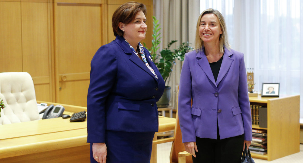 European Union High Representative Federica Mogherini, right, and Lithuania's Speaker of the Parliament Loreta Grauziniene pose for photographers during a meeting at the Parliament's palace in Vilnius, Lithuania, Monday, Sept. 21, 2015