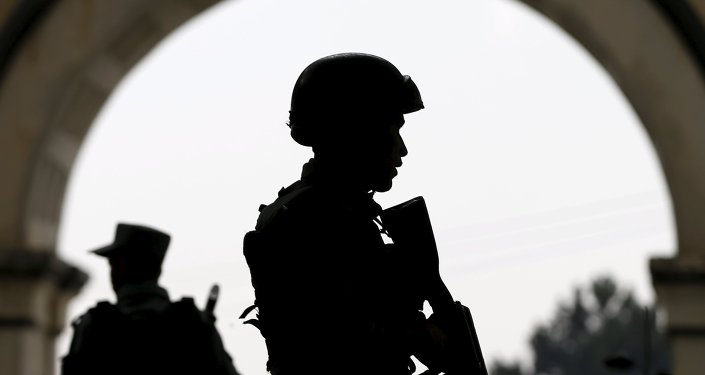 Afghan security forces stand guard.
