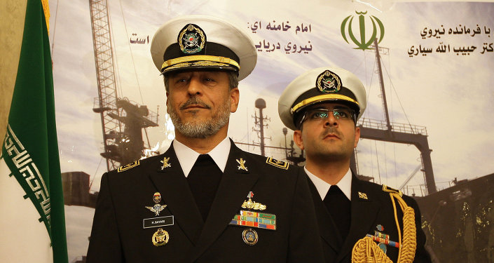 Rear Admiral Habibollah Sayyari (L), commander of the Iranian navy, stands under portraits of Iranian supreme leader Ayatollah Ali Khamenei and late revolutionary founder Ayatollah Khomeini (L) during a press conference at the Iranian embassy in the Syrian capital Damascus on February 28, 2011