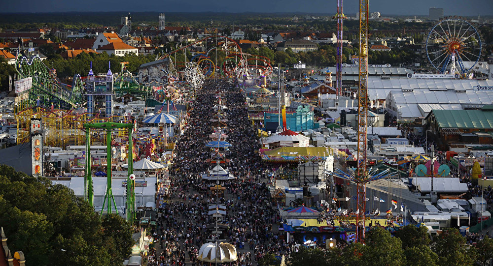 People enjoy the opening day of the 182nd Oktoberfest beer festival in Munich, southern Germany, Saturday, Sept. 19, 2015