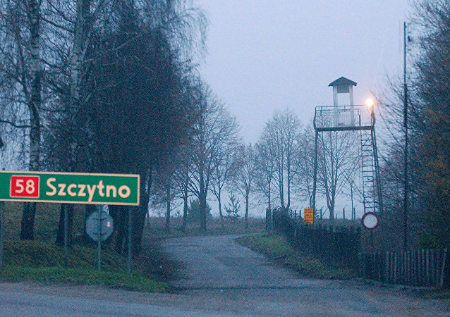 In this Friday, Dec. 16, 2005 file photo, a watch tower overlooks the area near the Polish intelligence school just outside of Stare Kiejkuty, Poland.