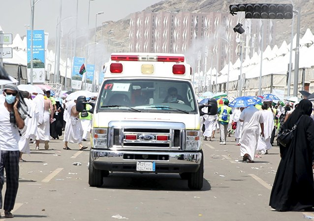 An ambulance evacuates victims following a crush caused by large numbers of people pushing at Mina, outside the Muslim holy city of Mecca September 24, 2015.