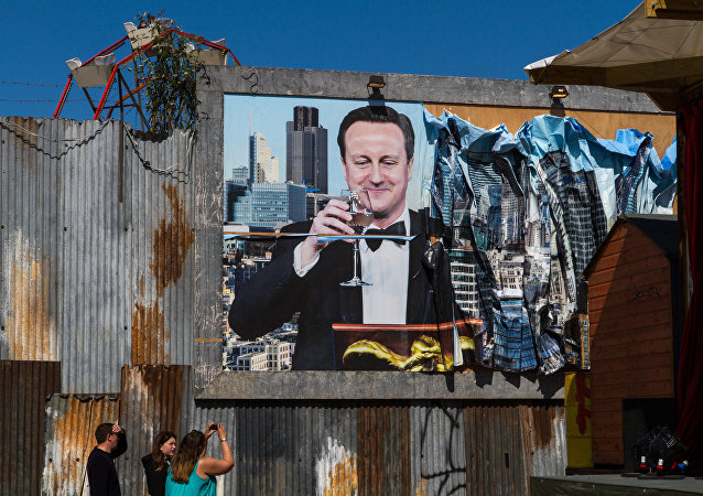 A poster of British PM David Cameron at Dismaland.