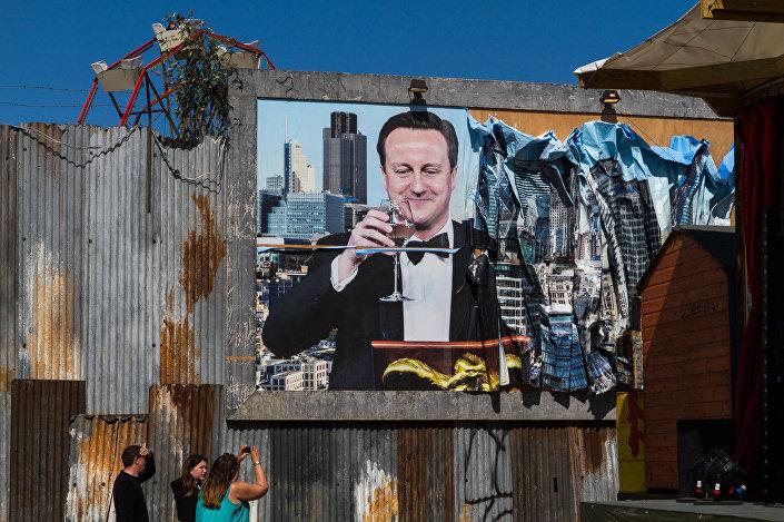 A poster of British PM David Cameron at Dismaland.