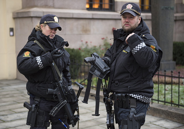 Armed police officers are seen outside the Nobel institute in Oslo