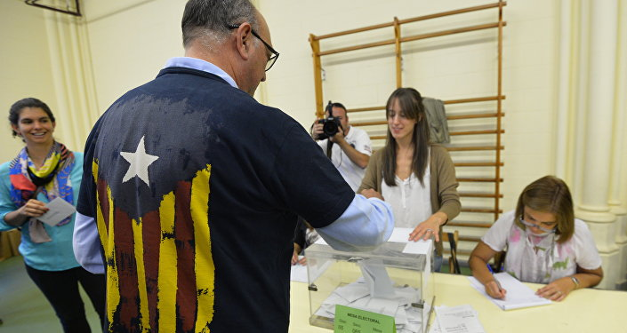 A man casts his ballot for the regional election at a polling station in Barcelona on September 27, 2015