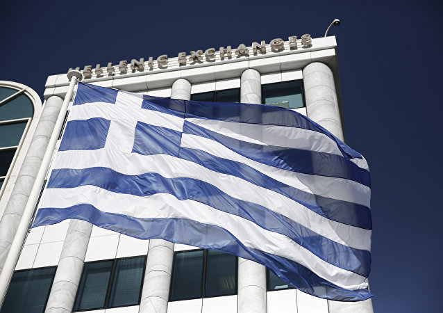 FILE - In this Feb. 3, 2015, file photo, a Greek flag flies outside the Athens Stock Exchange