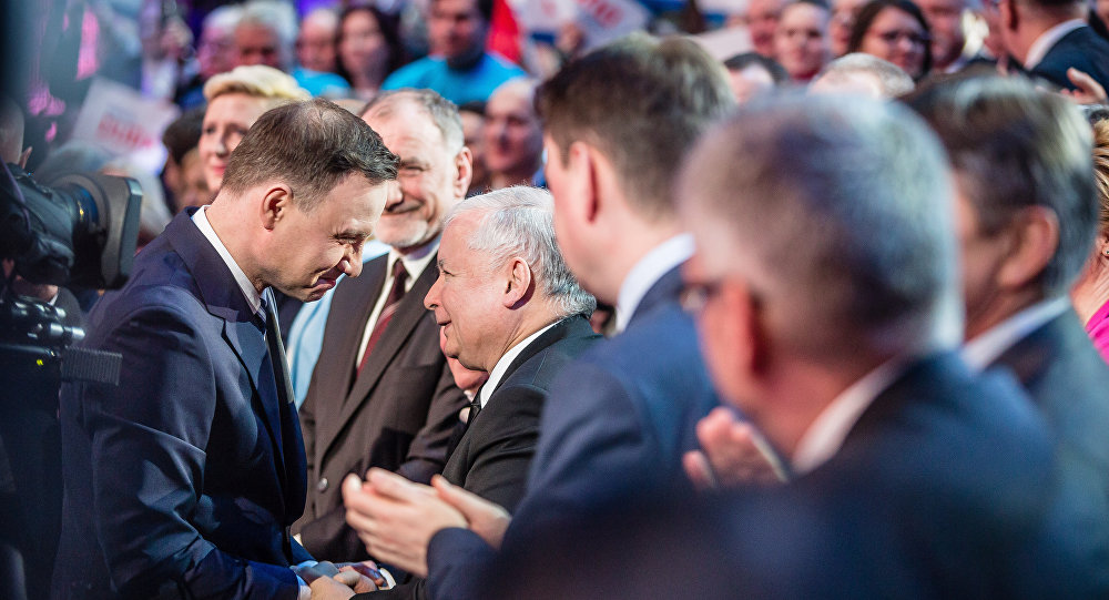 Andrzej Duda, and Jaroslaw Kaczynski (C) seen shaking hands during a party convection in Warsaw, February 7, 2015.