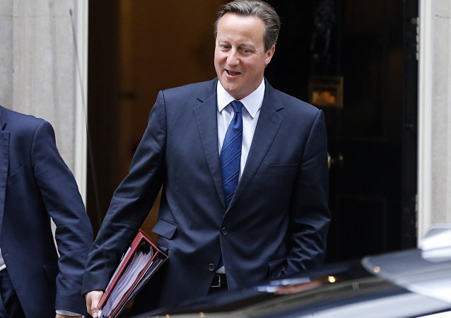 British Prime Minister David Cameron departs his official residence 10 Downing Street, for Prime Minister's Questions at the House of Commons in London, Wednesday, Sept. 9, 2015.