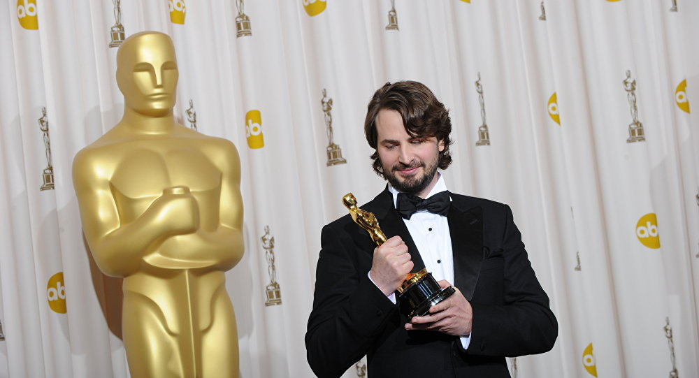 Mark Boal, winner of the best Original Screenplay for The Hurt Locker, poses with the Oscart at the 82nd Academy Awards at the Kodak Theater in Hollywood, California on March 07, 2010