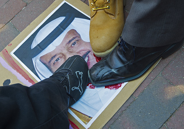Protesters step on a photo of Saudi King Salman on September 4, 2015.