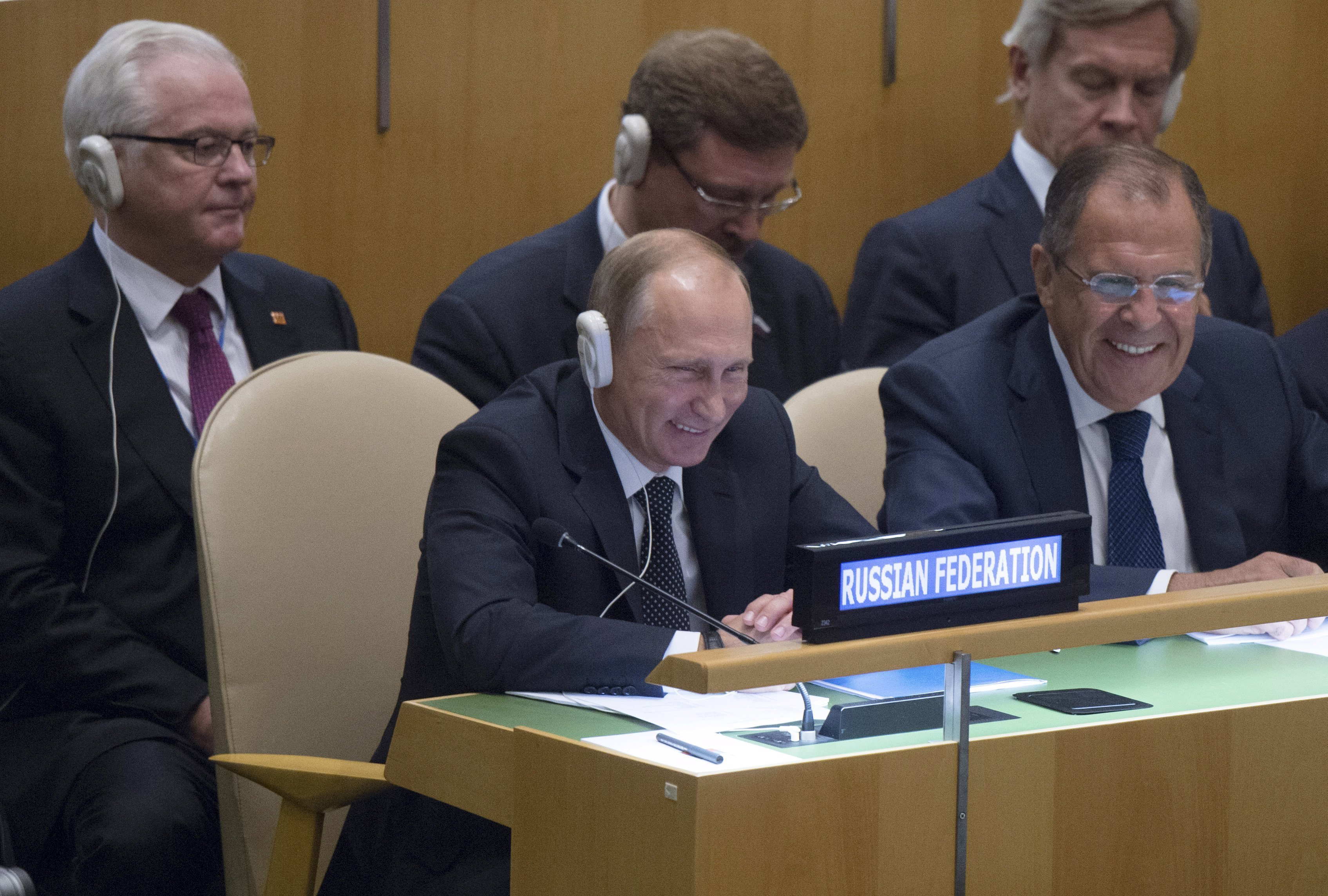 Russian President Vladimir Putin (L, front), Foreign Minister Sergei Lavrov (R, front), Russian U.N. Ambassador Vitaly Churkin (L, back) and other members of the delegation attend the 70th session of the United Nations General Assembly at the U.N. headquarters in New York, September 28, 2015