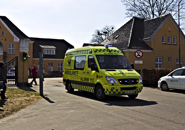 An ambulance leaves the Sandholm asylum seekers camp, about 20 miles (30 kilometers) north of Copenhagen, Denmark, Wednesday April 7, 2010, after a riot between Afghan and Chechan inmates caused at least one death
