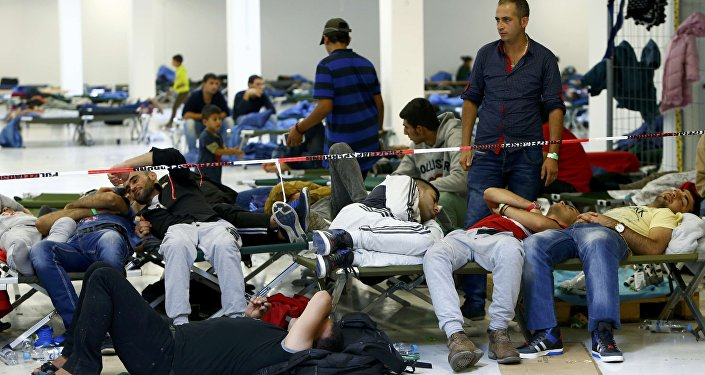 Migrants rest on camp beds at a temporary shelter in Freilassing, Germany September 17, 2015