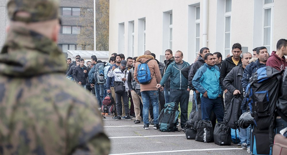 Asylum seekers arrive at a refugee reception centre in the northern town of Tornio, Finland September 25, 2015