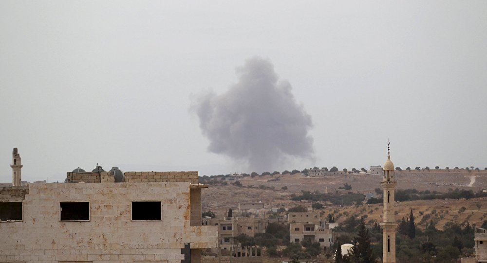 Smoke rises from a base controlled by rebel fighters from the Ahrar al-Sham Movement, that was targeted by what activists said were Russian airstrikes at Hass ancient cemeteries in the southern countryside of Idlib, Syria October 1, 2015.