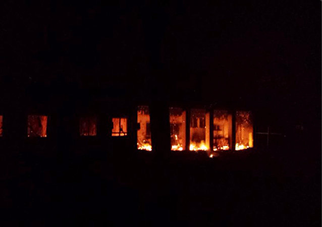 The Doctors Without Borders trauma center is seen in flames after explosions near their hospital, in the northern Afghan city of Kunduz