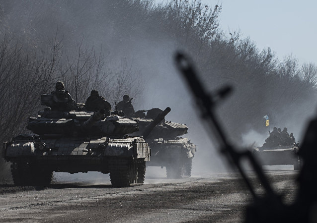 Ukrainian troops ride on tanks near Artemivsk, eastern Ukraine, Tuesday, Feb. 24, 2015