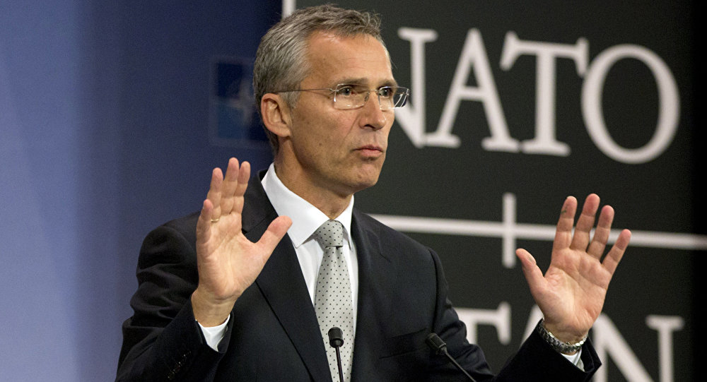 NATO Secretary General Jens Stoltenberg speaks during a media conference at NATO headquarters in Brussels on Tuesday, Oct. 6, 2015