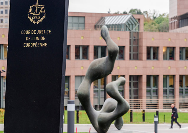 In this photo taken on Monday, Oct. 5, 2015 a man walks by the European Court of Justice in Luxembourg