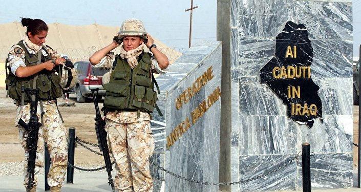 File photo of two Italian female soldiers wear their helmets as they pause next the monument in the memory of Nasiriyah's victims, at camp Mittica military base, in Nasiriyah, Iraq, Thursday, Nov. 11, 2004