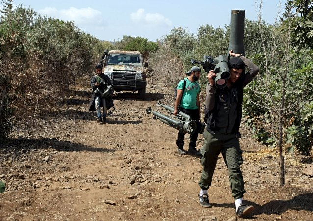 Free Syrian Army militants carry a weapon during what they said was preparations for an operation to strike at forces loyal to Syria's President Bashar Assad. File photo