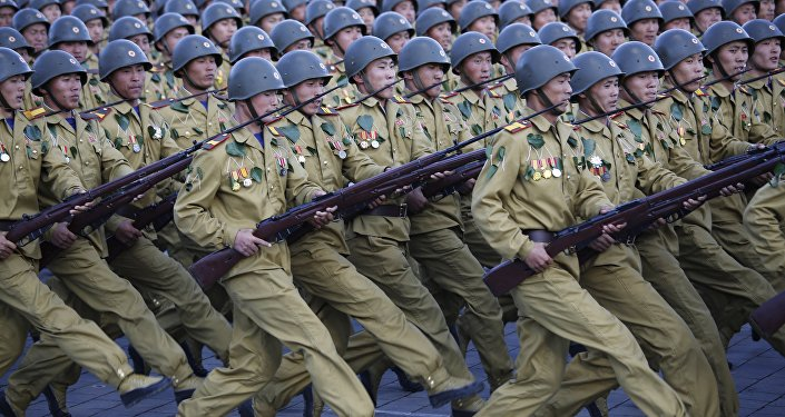North Korean soldiers parade on Kim Il Sung Square, Saturday, Oct. 10, 2015, in Pyongyang, North Korea
