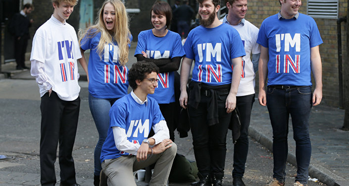 Supporters pose for photographers at Brick Lane in London, ahead of the launch of the Britain Stronger in Europe campaign, Monday, Oct. 12, 2015. A referendum is expected to be held in the UK before the end of 2017 on whether Britain should remain part of the European Union.