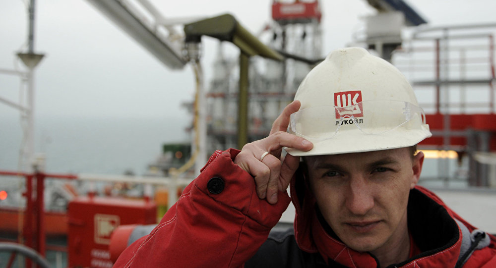 File photo of a worker stands near a pipe on the Russian LUKOIL ice-resistant fixed platform LSP-1