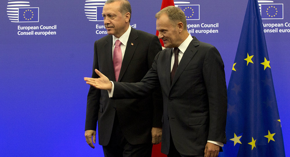 Turkish President Recep Tayyip Erdogan, left, is greeted by European Council President Donald Tusk prior to a meeting at the EU Council building in Brussels on Monday, Oct. 5, 2015.