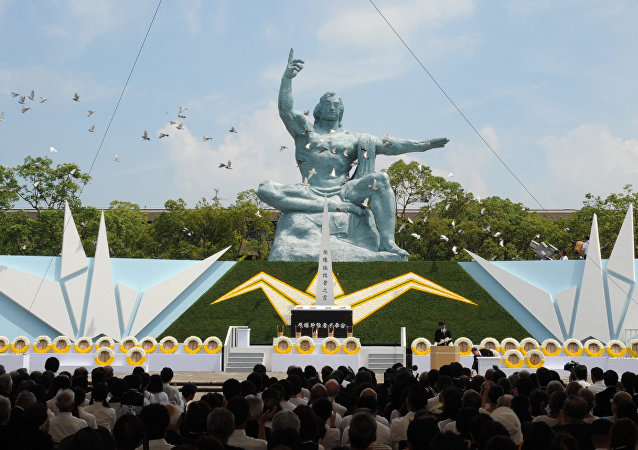 Doves fly over the Peace Statue during a memorial ceremony to mark the 70th anniversary of the atomic bombing of Nagasaki on August 9, 2015