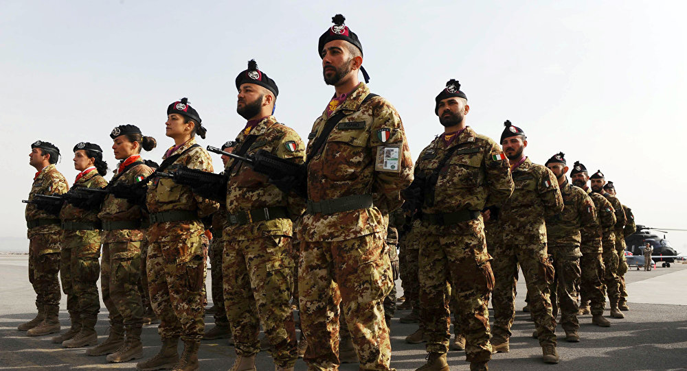 Italian soldiers stand to attention during a change of command ceremony at an Italian military camp near Herat airport