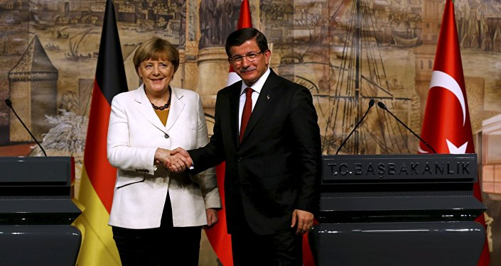 German Chancellor Angela Merkel meets Turkish Prime Minister Ahmet Davutoglu (R) in Istanbul, Turkey