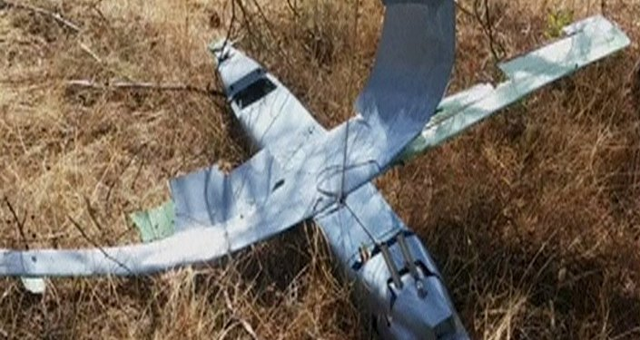 A still photograph used in a video shows a downed drone in Deliosman Village, Turkey October 16, 2015. Turkish warplanes shot down the unidentified drone in Turkish air space near Syria on Friday and a U.S. official said Washington believed it was of Russian origin
